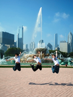 Cesar Corrales, Giuseppe Bausilio and Tommy Batchelor take a leap in front of Buckingham Fountain